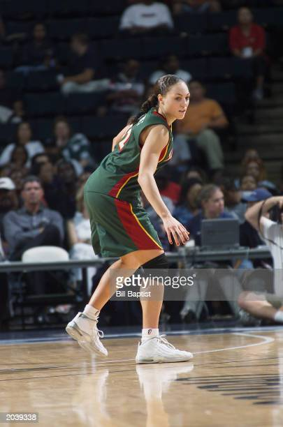 Adia Barnes of the Seattle Storm dribbles against the Houston Comets during the game on May 22 2003 at Compaq Center in Houston Texas The Comets won...