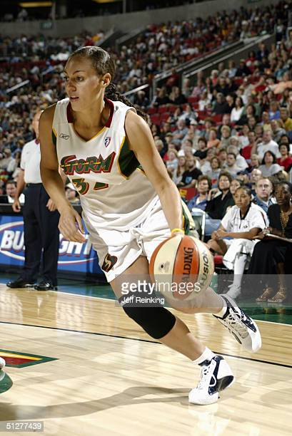 Adia Barnes of the Seattle Storm drives against the the Sacramento Monarchs during the game at Key Arena on September 1 2004 in Seattle Washington...