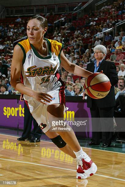 Adia Barnes of the Seattle Storm drives to the basket during the game against the Cleveland Rockers on July 12 2002 at Key Arena in Seattle...