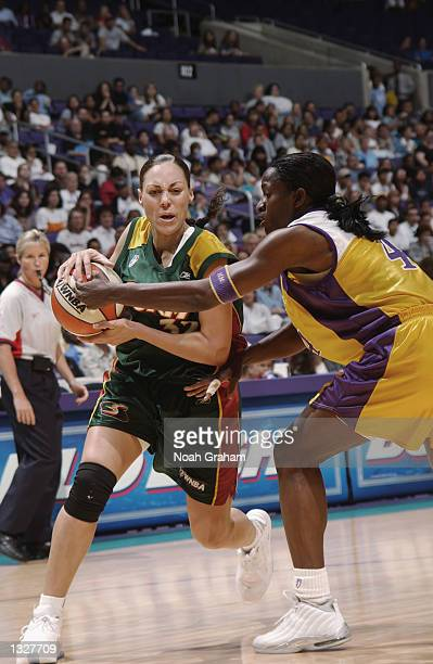 Adia Barnes of the Seattle Storm is defended by Mwadi Mabika of the Los Angeles Sparks on August 1 2002 at Staples Center in Los Angeles California...