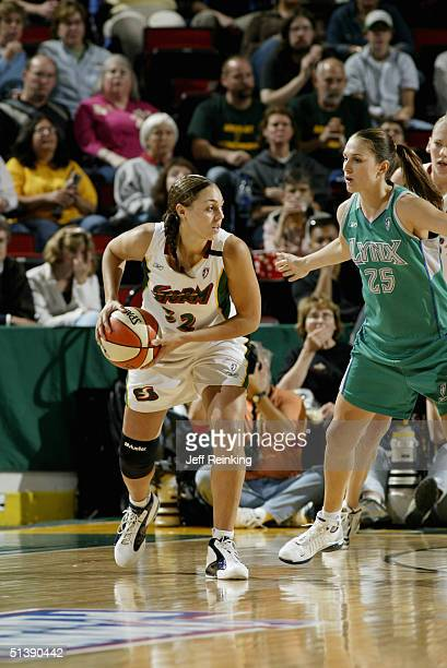 Adia Barnes of the Seattle Storm is defended by Svetlana Abrosimova of the Minnesota Lynx during the 2004 WNBA playoff game on September 27 2004 at...