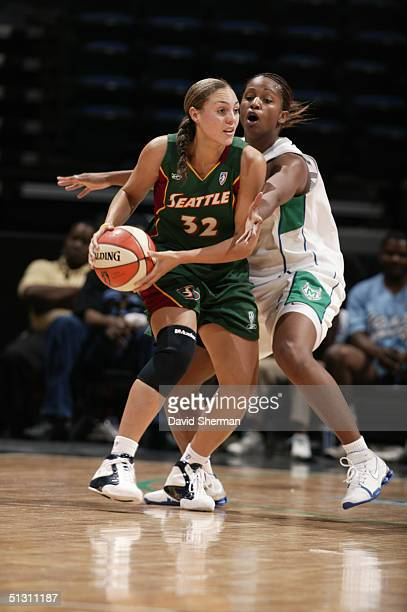 Adia Barnes of the Seattle Storm is defended by Tamika Williams of the Minnesota Lynx during the game at the Target Center on September 10 2004 in...