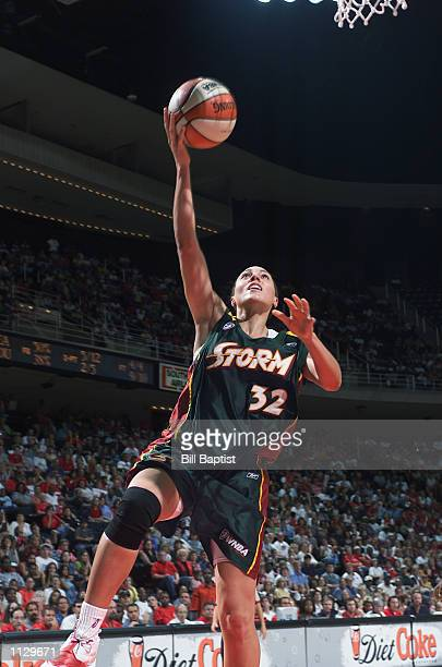 Adia Barnes of the Seattle Storm lays a shot up during the game against the Houston Comets on July 9 2002 at Compaq Center in Houston Texas The...
