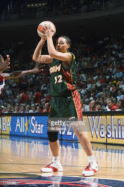 Adia Barnes of the Seattle Storm looks to pass during the game against the Houston Comets on July 9 2002 at Compaq Center in Houston Texas The Comets...