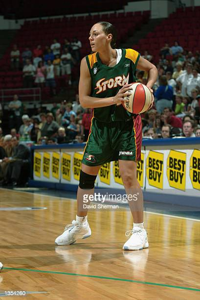 Adia Barnes of the Seattle Storm looks to pass during the game against the Minnesota Lynx on August 4 2002 at Target Center in Minneapolis Minnesota...