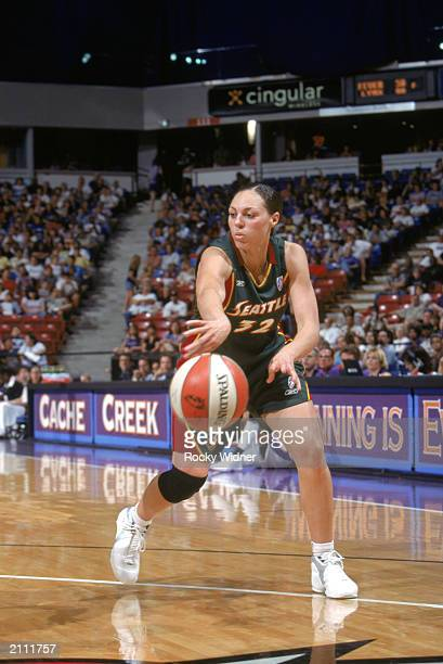 Adia Barnes of the Seattle Storm passes the ball during the WNBA game against the Sacramento Monarchs on June 21 2003 at ARCO Arena in Sacramento...