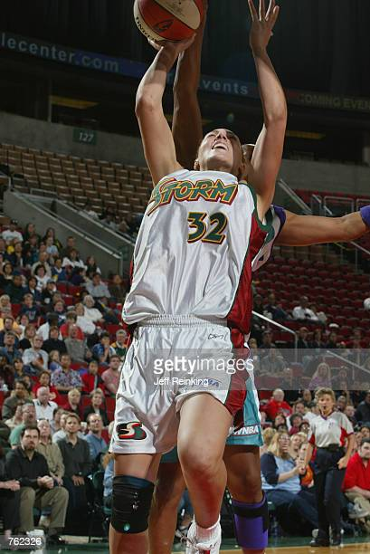 Adia Barnes of the Seattle Storm puts up a shot during the game against the Charlotte Sting at Key Arena in Seattle Washington on June 6 2002 The...