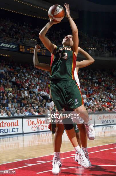 Adia Barnes of the Seattle Storm shoots against the Houston Comets during the game on May 22 2003 at Compaq Center in Houston Texas The Comets won...
