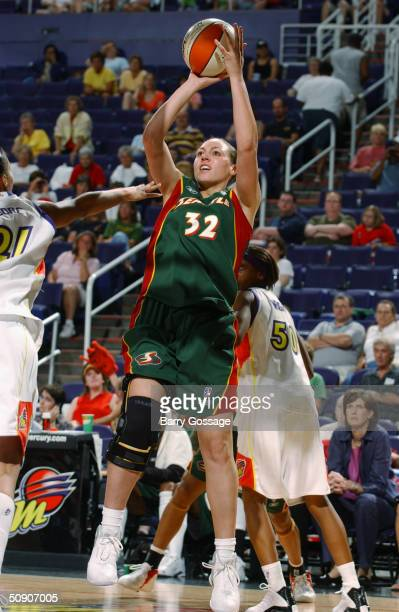 Adia Barnes of the Seattle Storm shoots against the Phoenix Mercury during a WNBA preseason game at America West Arena on May 5 2004 in Phoenix...