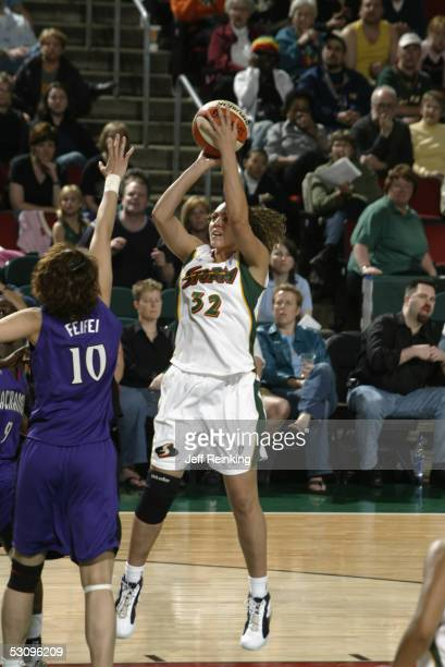 Adia Barnes of the Seattle Storm shoots over Sui Feifei of the Sacramento Monarchs during a preseason game at Key Arena on May 14 2005 in Seattle...