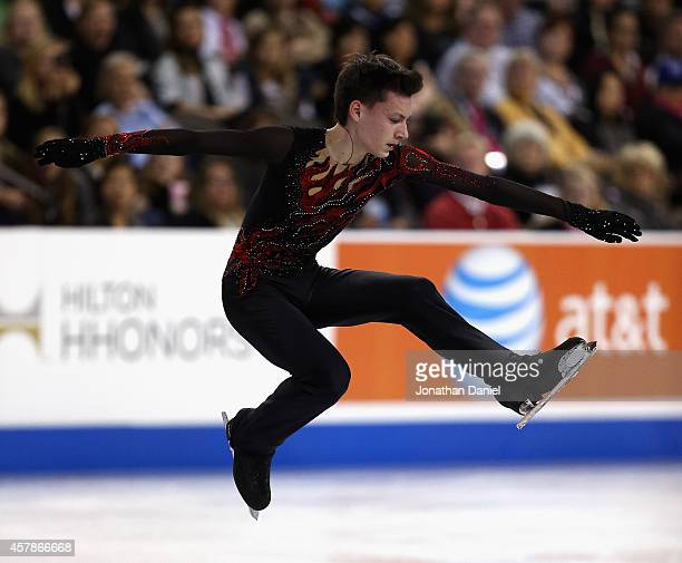 Adian Pitkeev competes during the Men Free Skating during the 2014 Hilton HHonors Skate America competition at the Sears Centre Arena on October 25...