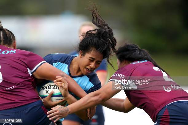 Adiana Talakai of the Waratahs is is tackled during the Super W Final match between the NSW Waratahs and the Queensland Reds at Coffs Harbour...