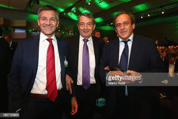 Adidas chairman Herbert Hainer DFB president Wolfgang Niersbach and UEFA president Michel Platini pose prior to the DFB Bundestag at the NCC...