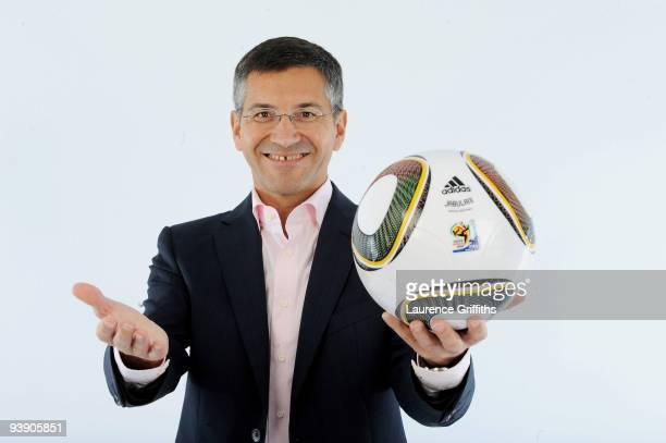 Adidas Chief Executive Herbert Hainer presents the official match ball for the FIFA World Cup 2010 on December 4 2009 in Cape Town South Africa