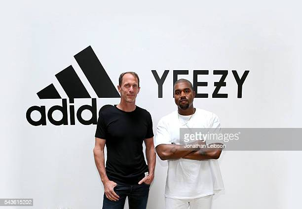 Adidas CMO Eric Liedtke and Kanye West at Milk Studios on June 28, 2016 in Hollywood, California. Adidas and Kanye West announce the future of their...