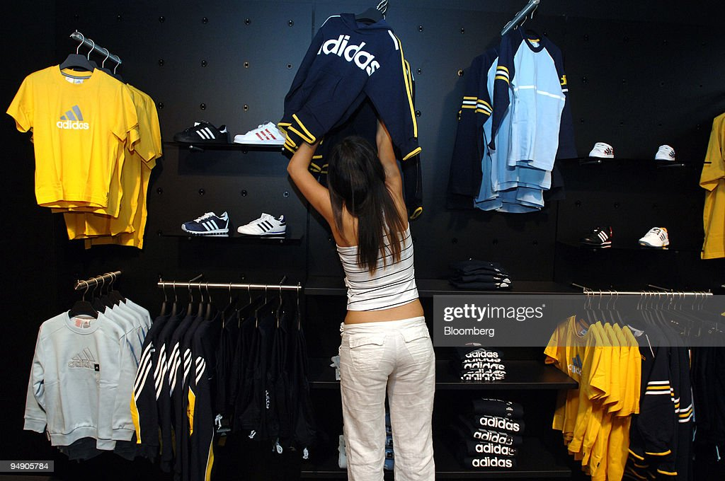 017da3df5995 Adidas employee Figen Acikel arranges stock in an Adidas sto   News Photo