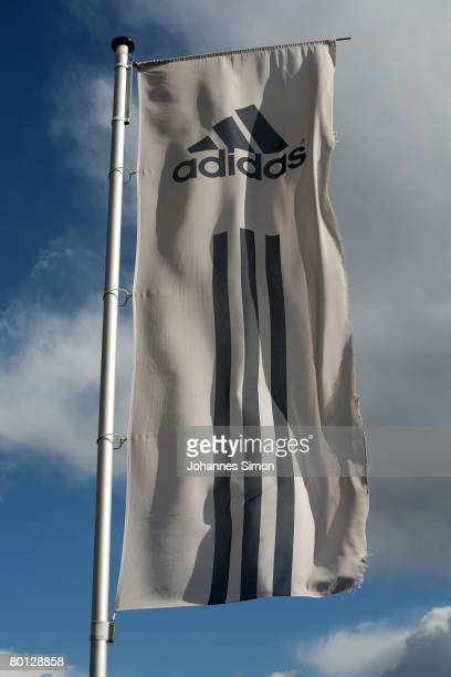 Adidas flag waves in front of the Adidas factory outlet store seen after the announcement of the results 2007 on March 5 2008 in Herzogenaurach...