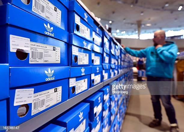 Adidas footwear is seen in branded boxes on display at the Adidas AG outlet store in Herzogenaurach Germany on Thursday March 7 2013 Adidas AG the...