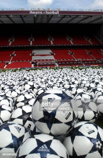 Adidas match balls are laid out on the Old Trafford pitch before 915 of them are donated to all the schools in the Manchester Area