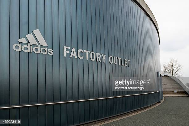 adidas, outlet store, herzogenaurach - herzogenaurach stock pictures, royalty-free photos & images