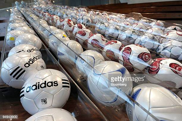 Adidas soccer balls sit on display at an Adidas outlet store in Herzogenaurach, Germany, on Wednesday, March 4, 2009. Adidas AG , the world's...