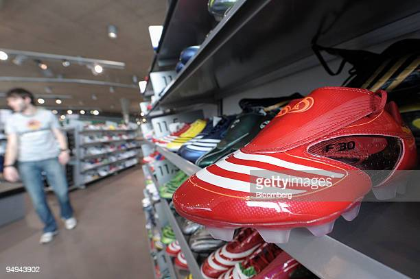 Adidas soccer boots sit on display at an Adidas outlet store in Herzogenaurach, Germany, on Wednesday, March 4, 2009. Adidas AG , the world's...