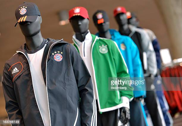 Adidasbranded clothing is displayed on mannequins at the Adidas AG outlet store in Herzogenaurach Germany on Thursday March 7 2013 Adidas AG the...