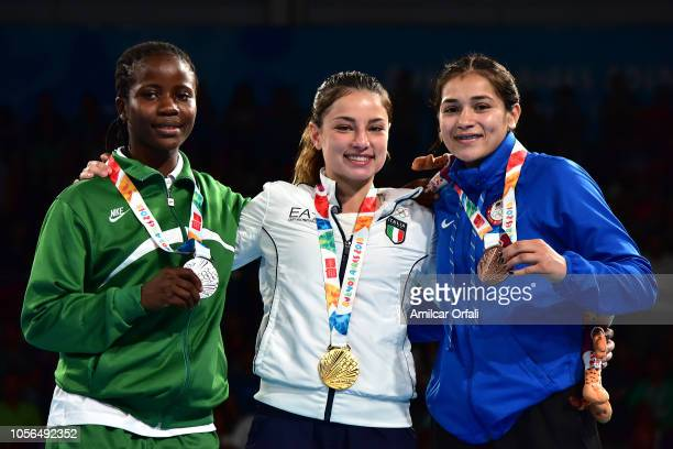 Adijat Gbadamosi of Nigeria Martina La Piana of Italy and Heaven Destiny Garcia of United States pose in the podium of Women's Fly during day 12 of...
