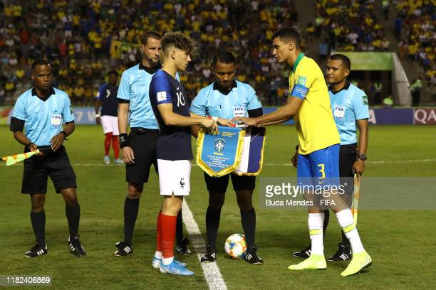 Adil Aouchiche of France and Henri of Brazil exchange pennants prior to the FIFA U17 World Cup Brazil 2019 semifinal match between France and Brazil...
