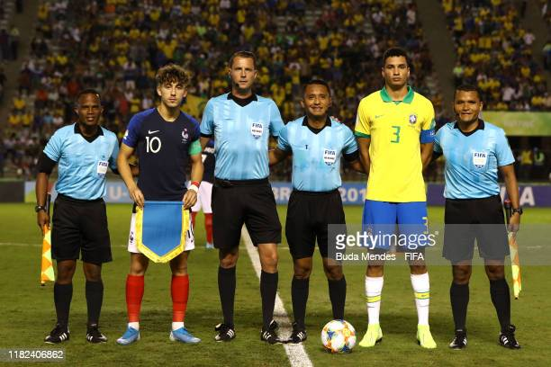 Adil Aouchiche of France and Henri of Brazil line up with the match officials prior to the FIFA U17 World Cup Brazil 2019 semifinal match between...