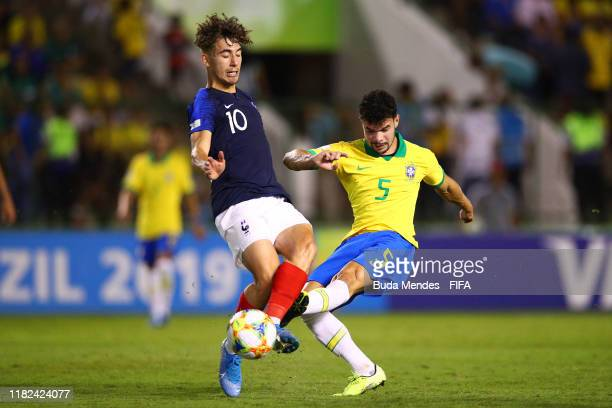 Adil Aouchiche of France competes with Daniel Cabral of Brazil during the FIFA U17 World Cup Brazil 2019 semifinal match between France and Brazil at...
