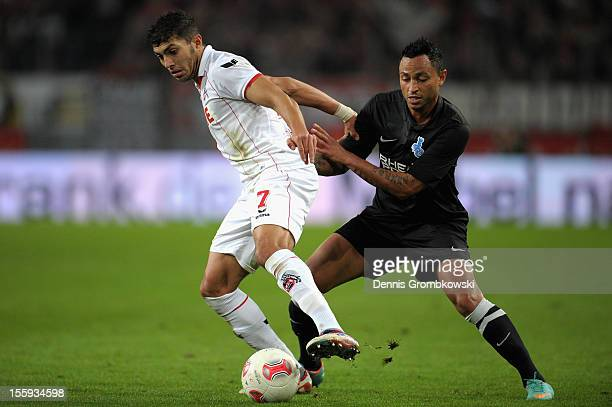 Adil Chihi of Cologne and Antonio da Silva of Duisburg battle for the ball during the Second Bundesliga match between 1 FC Koeln and MSV Duisburg at...