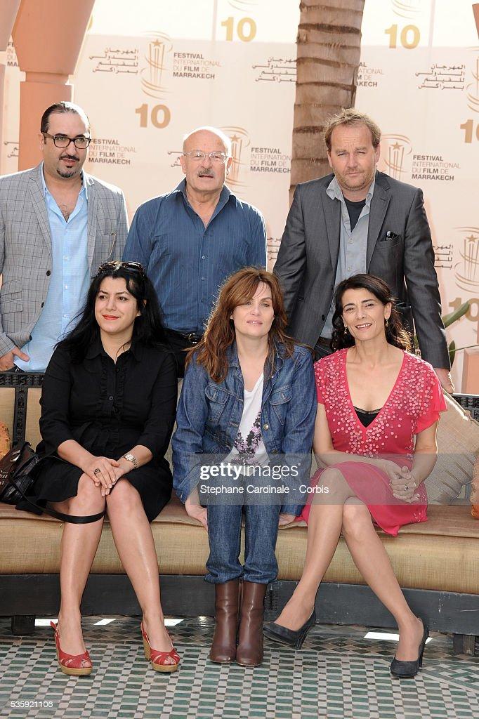 Adil El Fadili, Volker Schlondorff (President), Xavier Beauvois, Marjane Satrapi, Emmanuelle Seigner and Hiam Abbas attend the Photocall of the Short Film Jury, during the10th Marrakech Film Festival, in Marrakech.