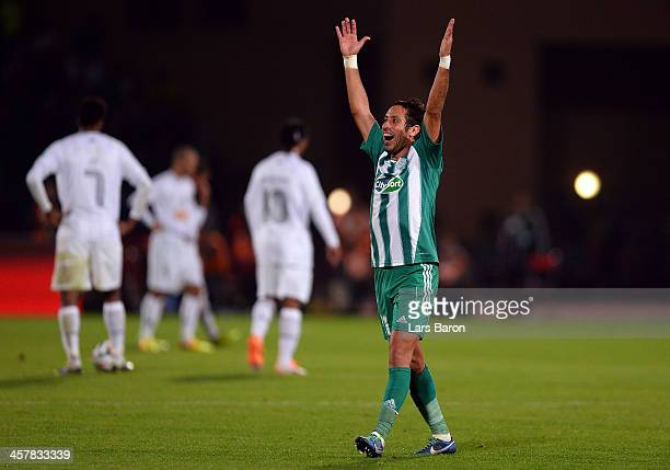 Adil Karrouchy celebrates after winning the FIFA Club World Cup Semi Final match between Raja Casablanca and Atletico Mineiro at Marrakech Stadium on...