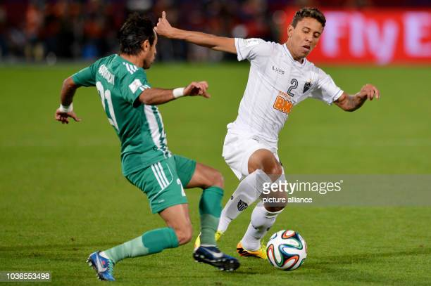 Adil Karrouchy of Casablanca and Marcos Rocha of Mineiro vie for the ball during the FIFA Club World Cup semi final soccer match between Raja...