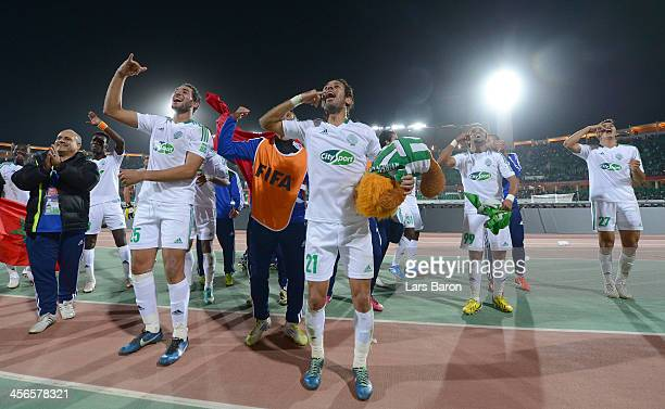 Adil Karrouchy of Casablanca celebrates with team mates after winning the FIFA Club World Cup Quarterfinal match between Raja Casablanca and CF...