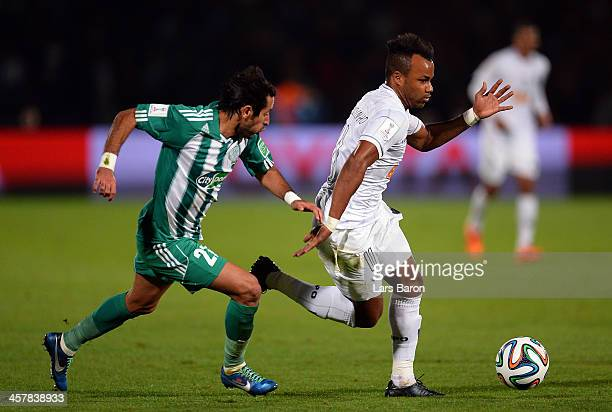Adil Karrouchy of Casablanca challenges Fernandinho of Mineiro the FIFA Club World Cup Semi Final match between Raja Casablanca and Atletico Mineiro...