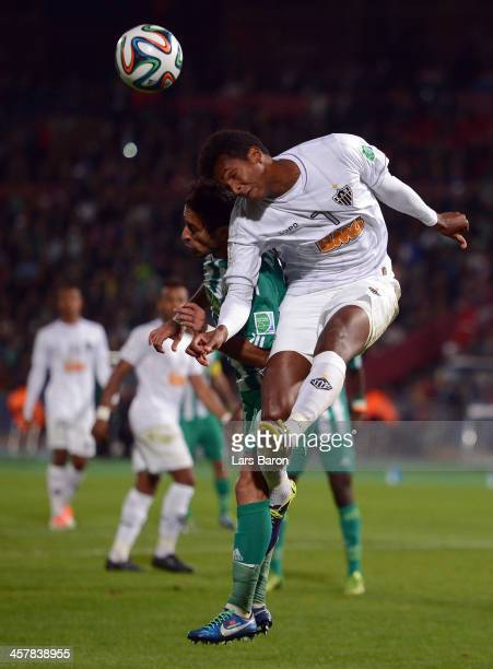 Adil Karrouchy of Casablanca goes up for a header with Jo of Mineiro during the FIFA Club World Cup Semi Final match between Raja Casablanca and...