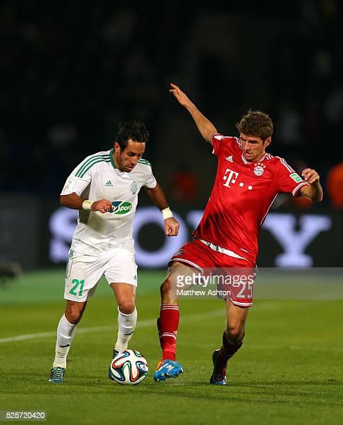 Adil Karrouchy of Raja Casablanca and Thomas Mueller of Bayern Munich