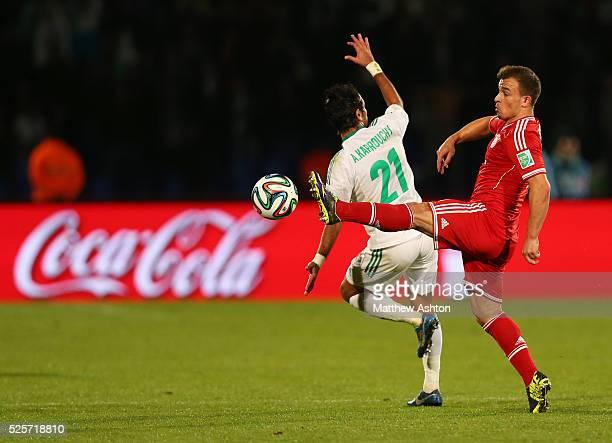 Adil Karrouchy of Raja Casablanca and Xherdan Shaqiri of Bayern Munich