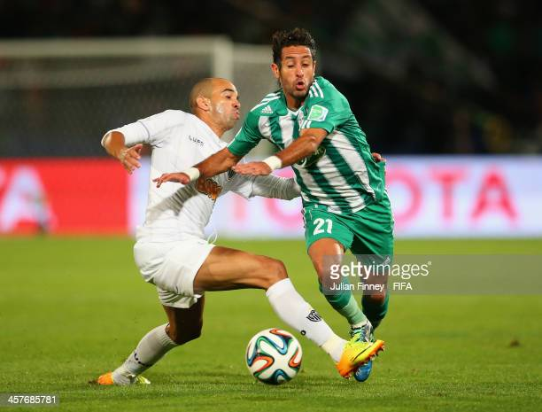Adil Karrouchy of Raja Casablanca battles with Diego Tardelli of Atletico Mineiro during the FIFA Club World Cup Semi Final match between Raja...