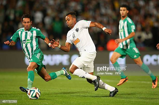 Adil Karrouchy of Raja Casablanca battles with Fernandinho of Atletico Mineiro during the FIFA Club World Cup Semi Final match between Raja...