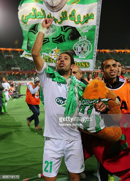 Adil Karrouchy of Raja Casablanca celebrates victory and a semifinal place in the FIFA Club World Cup 2013