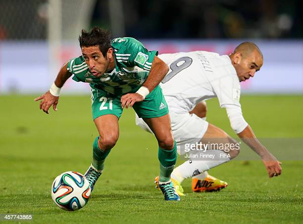 Adil Karrouchy of Raja Casablanca goes past Diego Tardelli of Atletico Mineiro during the FIFA Club World Cup Semi Final match between Raja...