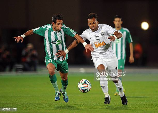 Adil Karrouchy of Raja Casablanca in action with Fernandinho of Atletico Mineiro during the FIFA Club World Cup Semi Final match between Raja...