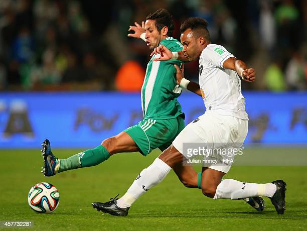Adil Karrouchy of Raja Casablanca tries to block Fernandinho of Atletico Mineiro during the FIFA Club World Cup Semi Final match between Raja...