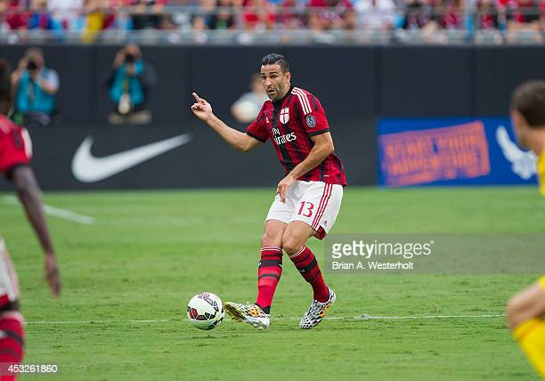 Adil Mai of AC Milan passes the ball during first half action against Liverpool in the Guinness International Champions Cup at Bank of America...