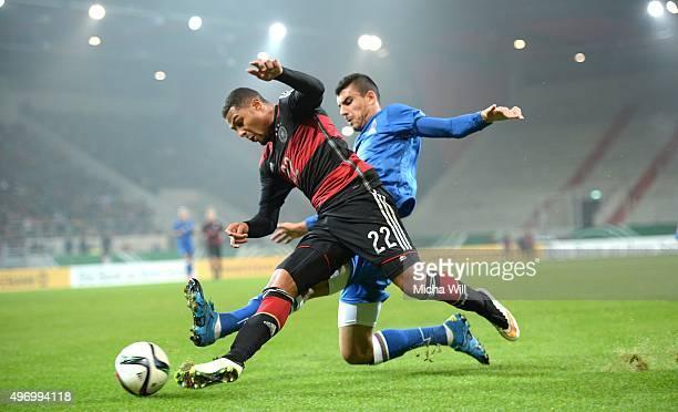Adil Nagiev of Azerbaijan challenges Serge Gnabry of Germany during the 2017 UEFA European U21 Championships Qualifier between U21 Germany and U21...
