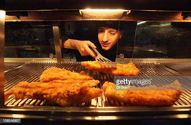 Adil Niazi prepares deep fried cod in the preparation of a traditional portion of fish and chips in Olley's fish restaurant on February 22 2011 in...