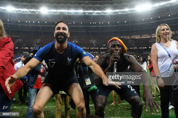 Adil Rami and Benjamin Mendy of France celebrate following their sides victory in the 2018 FIFA World Cup Final between France and Croatia at...